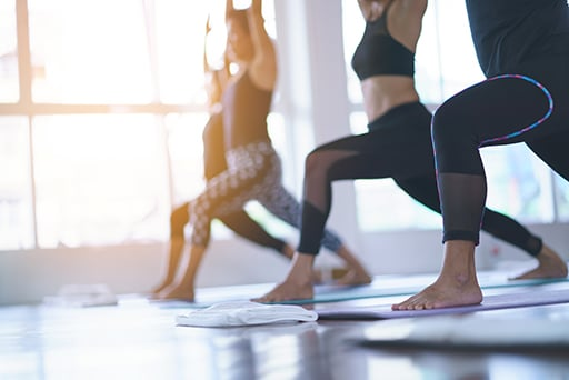 Women exercising in fitness studio yoga classes